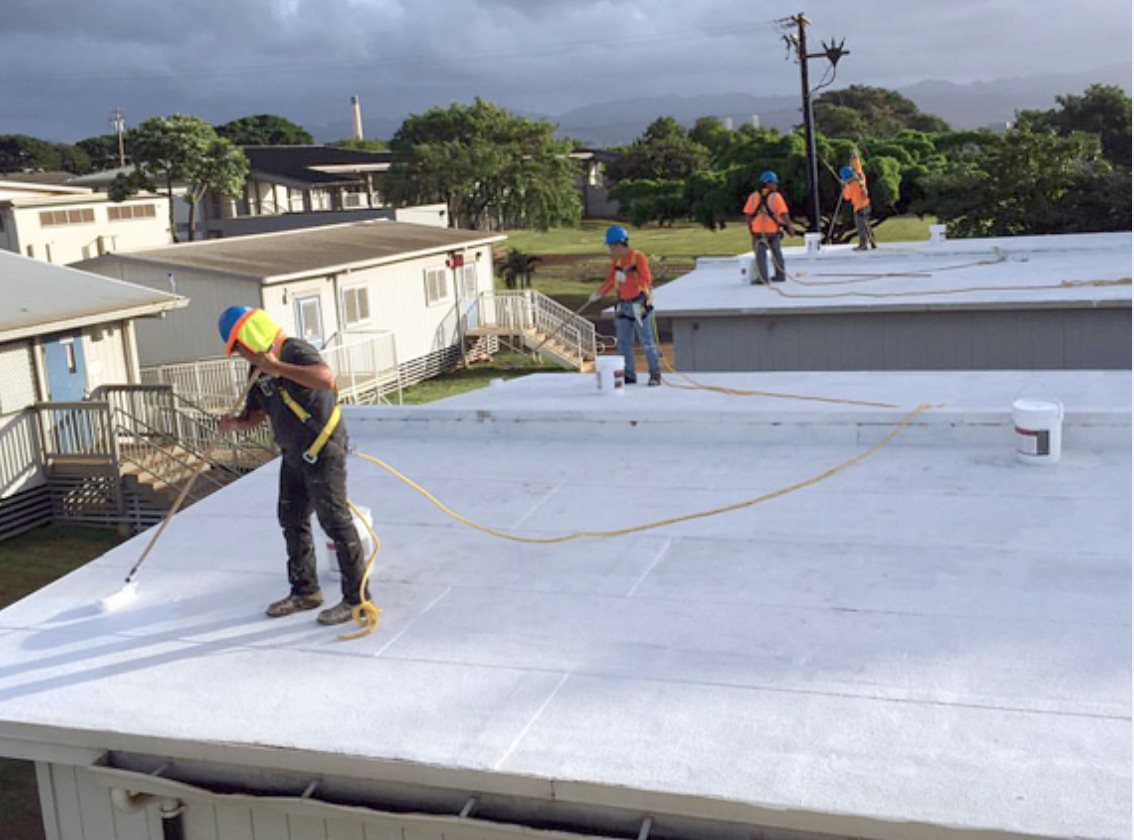 DOE workers applying heat-reflective paint to cool portable classrooms on on O`ahu. (DOE photo)